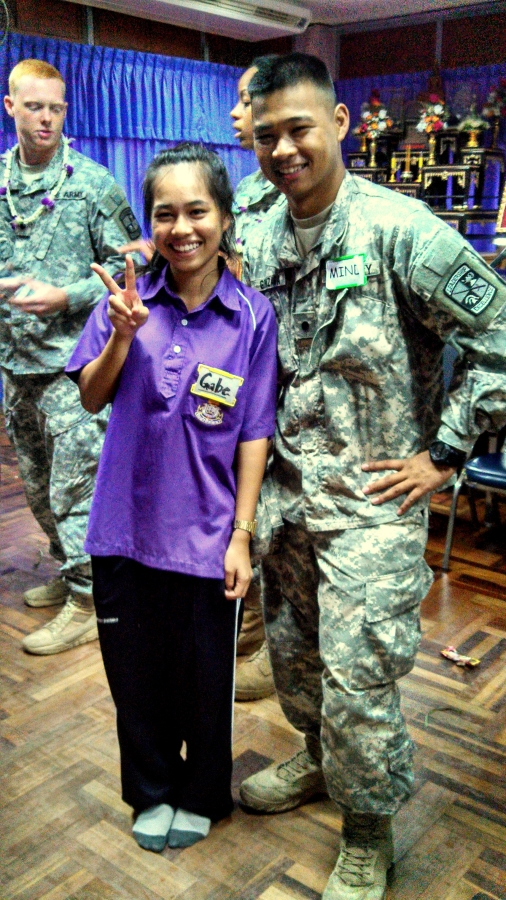 Cadet Gonzaga posing with a Thai High School Student during a meet and greet.