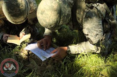 Cadets plan a route of travel during their Spring FTX